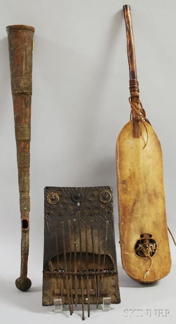 Three African Musical Instruments, metal side-blown trumpet, Congo, a thumb piano and a stringed instrument