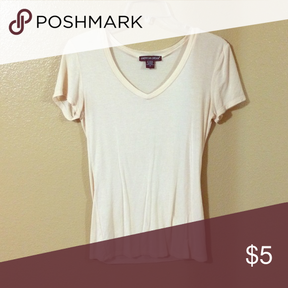 Tan T-shirt Is skin tight t-shirt. Barely worn. No stains. Thin material that clings very tight on me and I wear a medium. american dream Tops Tees - Short Sleeve