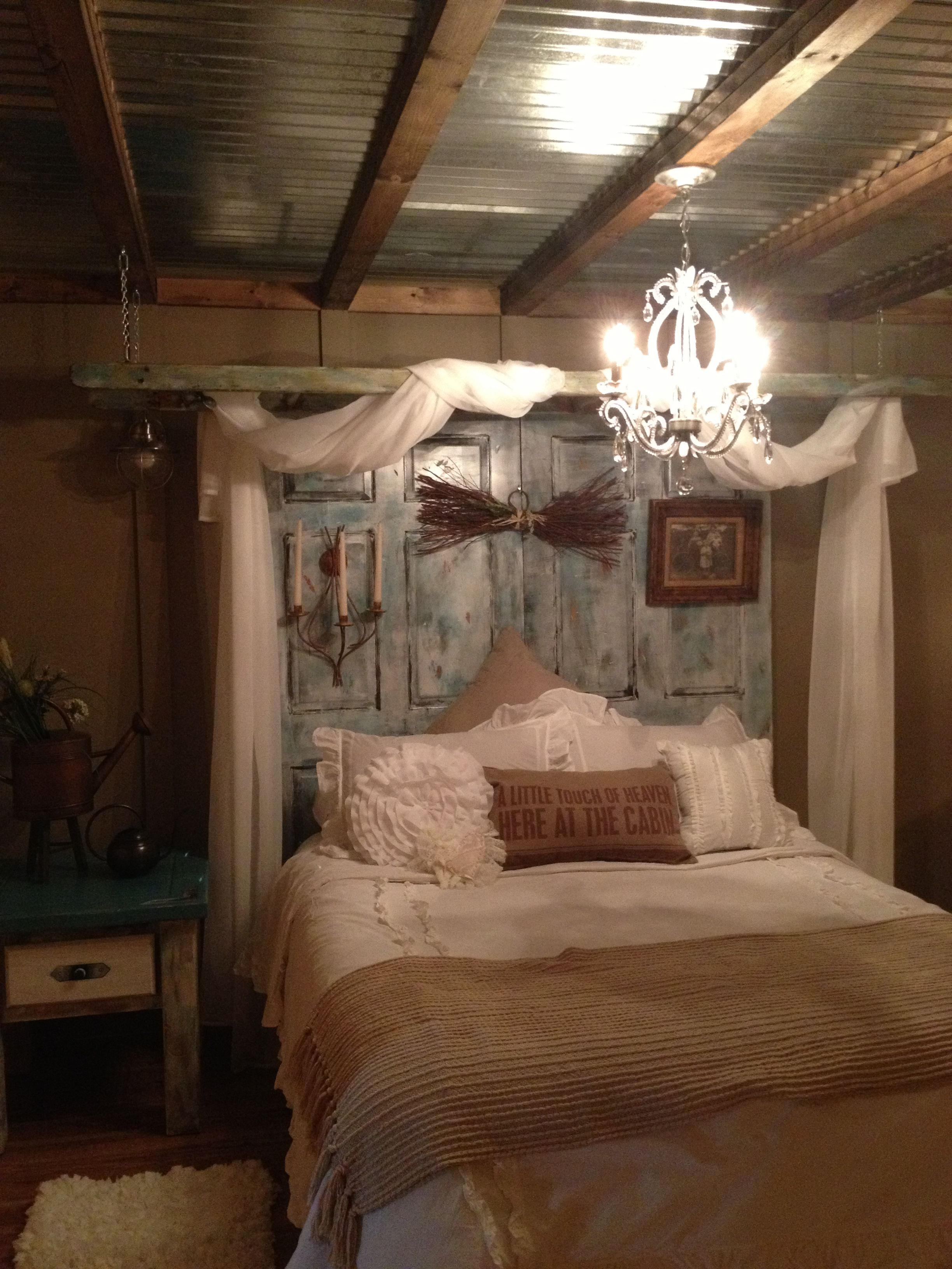 Bedroom ceiling drapes - Used Old Ladder For Curtains And Painted Old Doors For Headboard Tin Ceiling Drapes Rustic Looking Bedroom