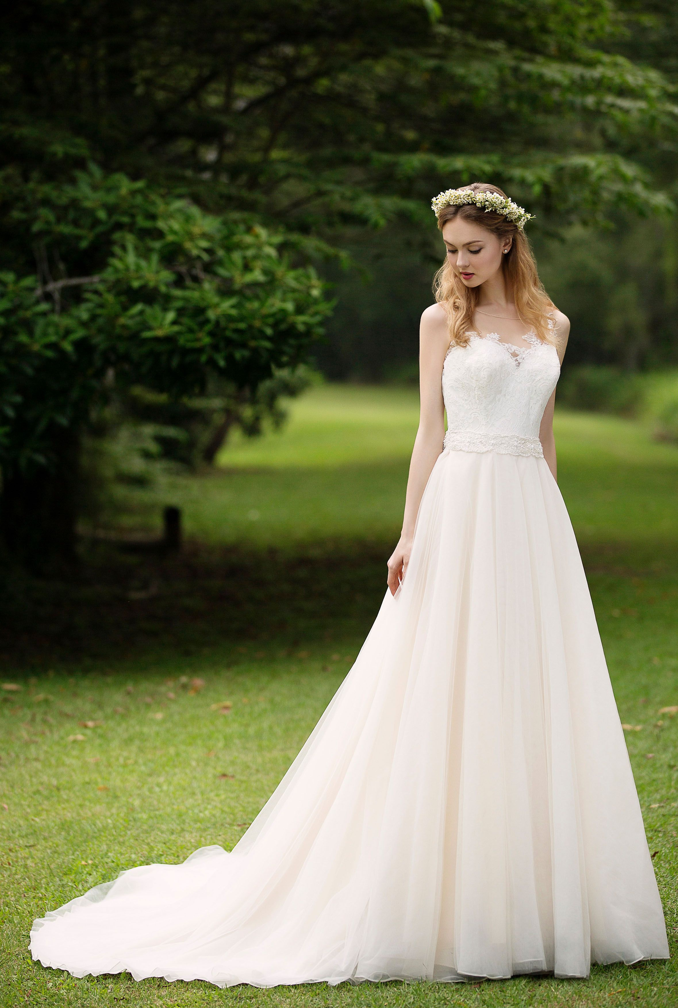 wedding gown rental Champagne tulle skirt paired with a gorgeous illusion back the ideal classic dress with a Wedding Gown RentalWedding