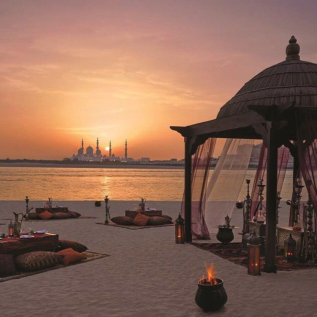 "Abu Dhabi beach, I reckon this is one of the hotel beaches in  ""Between the Two Bridges"" area with the Grand Sheikh Zayed Mosque in the horizon"