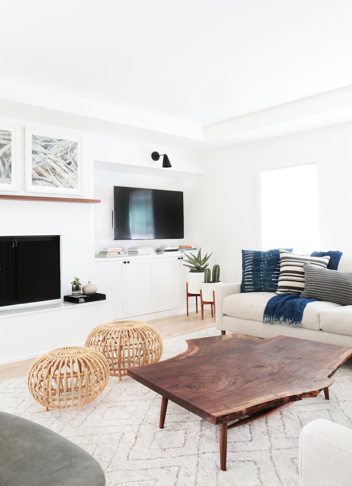 Living Rooms: Crisp white walls, light sofa, wood plank coffee table ...