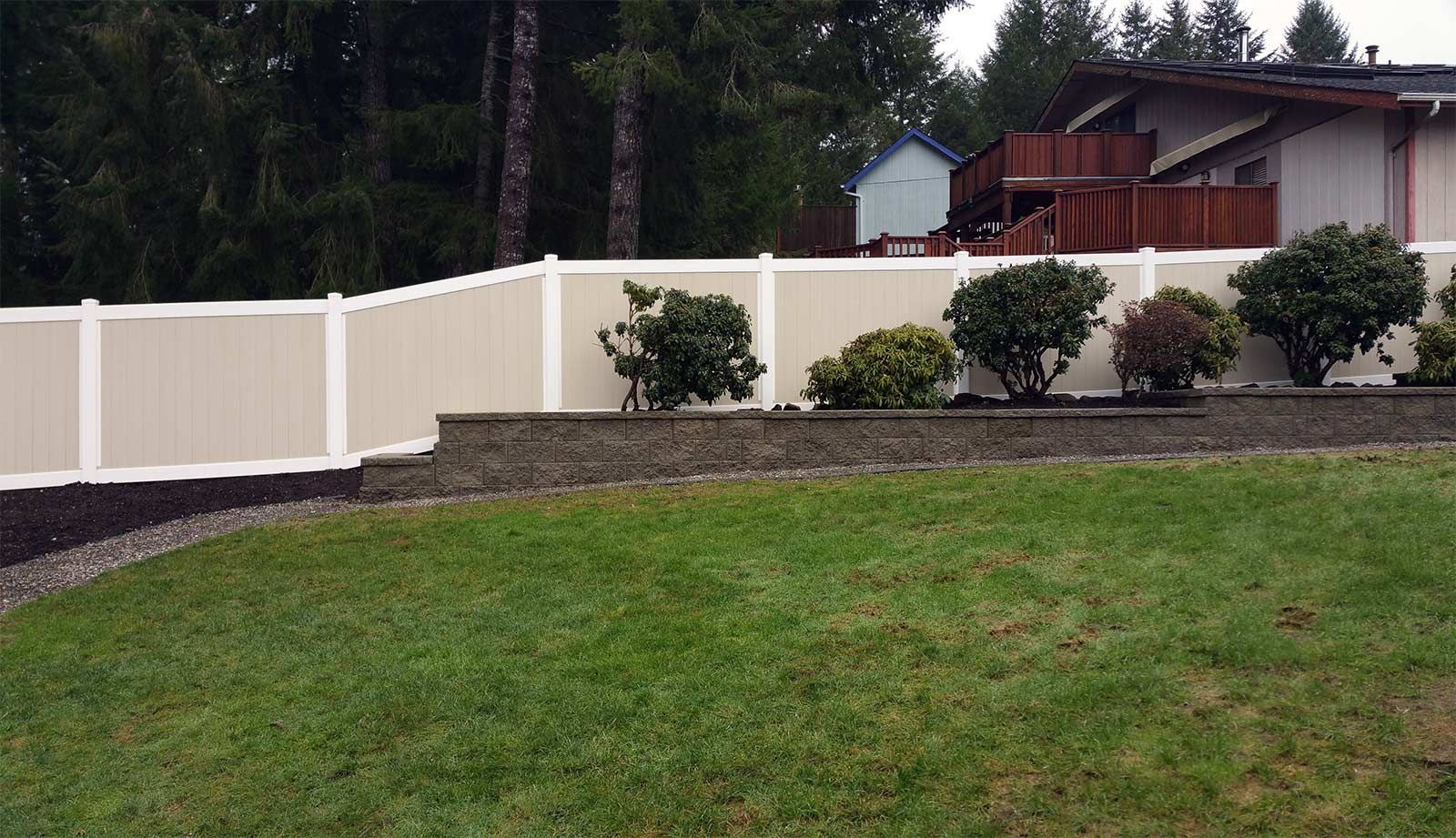 Tiered Retaining Wall With Vinyl Fencing In West Olympia Landscaping Around Patio Sloped Backyard Vinyl Fence