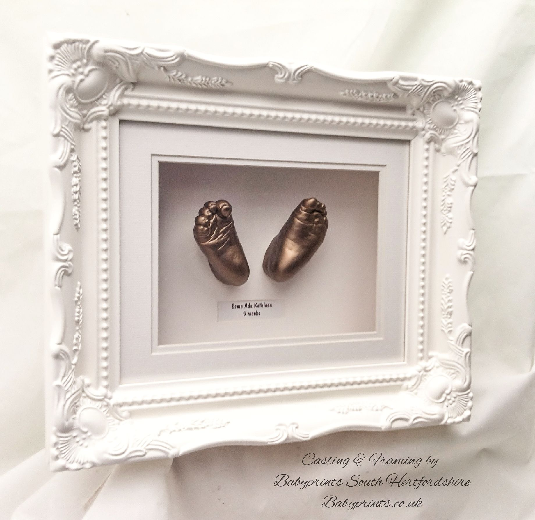 Classical baroque swept frame style with baby feet in bronze. By ...