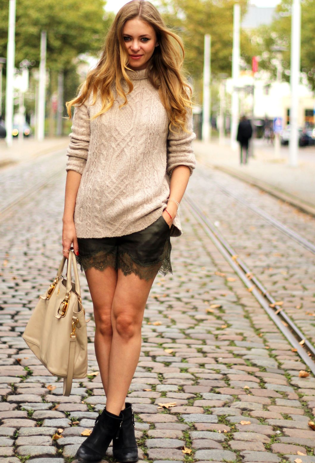 cream sweater and bag