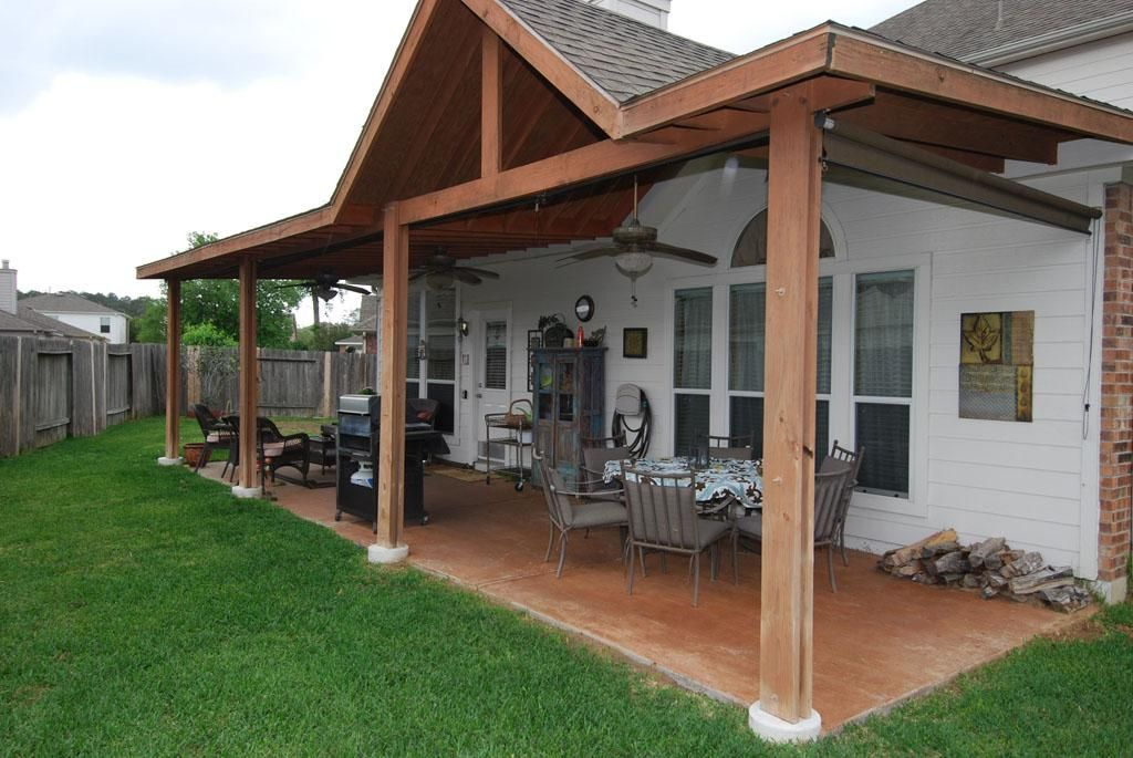 Beautiful Covered Back Porch With Ceiling Fans Is Perfect For