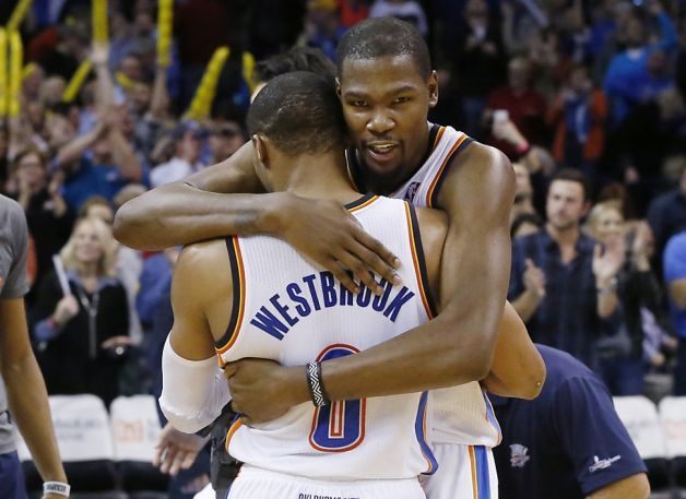 84dc4b48aea The Thunder s Kevin Durant hugs Russell Westbrook for making the  game-winning three-pointer in overtime. Photo  Sue Ogrocki