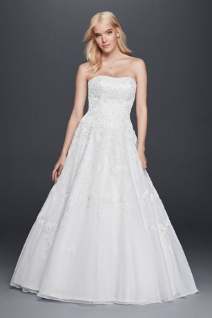 This lace wedding dress will truly make you feel like a bride. The drop waist silhouette adds a flattering modern element, while the ball gown silhouette and allover lace appliques supply a timeless touch.  David's Bridal Collection  Polyester  Chapel train  Back zipper; fully lined  Dry clean  Imported