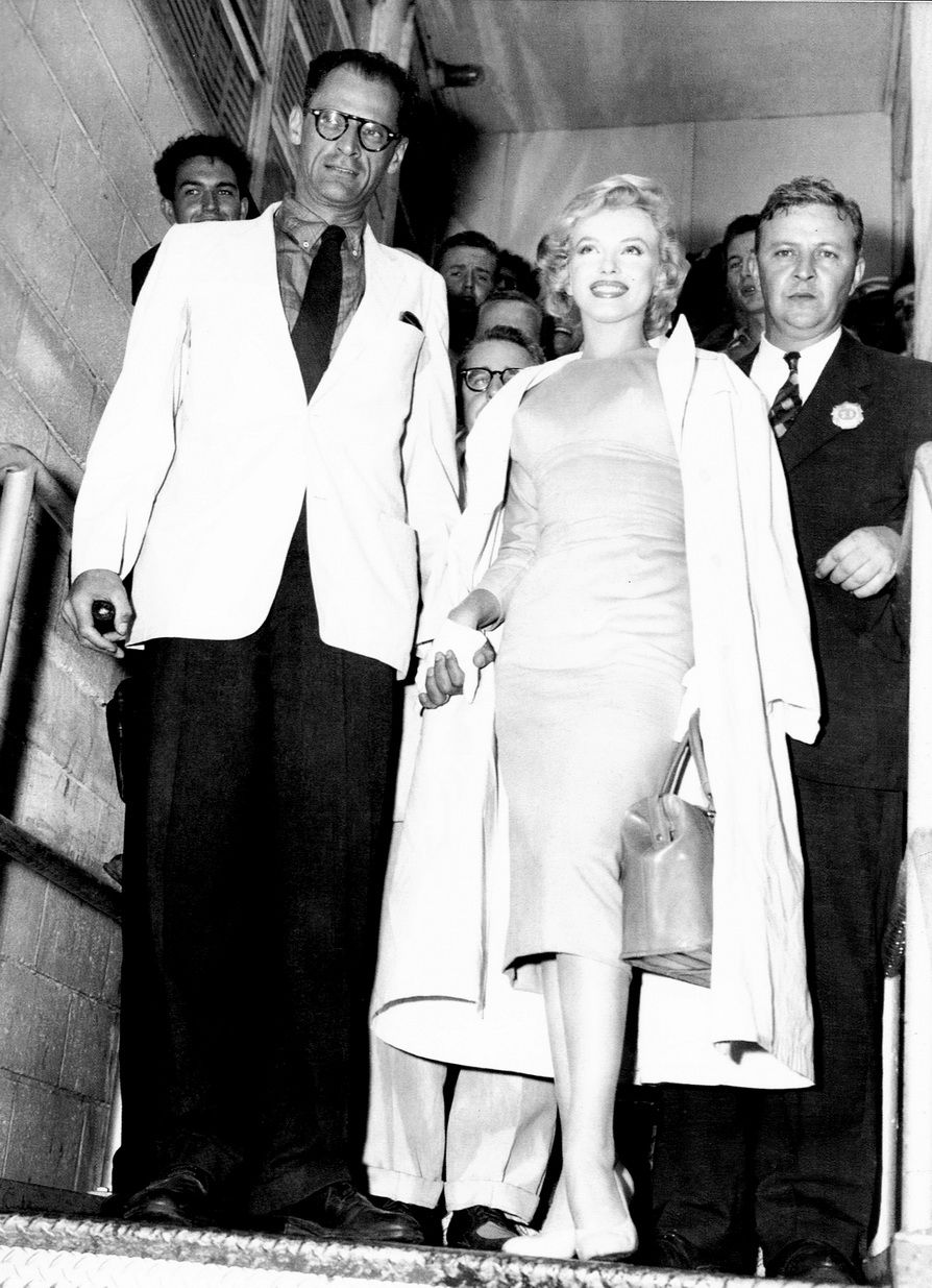 Marilyn Monroe and Arthur Miller depart for England in July, 1956 at Idlewild Airport.