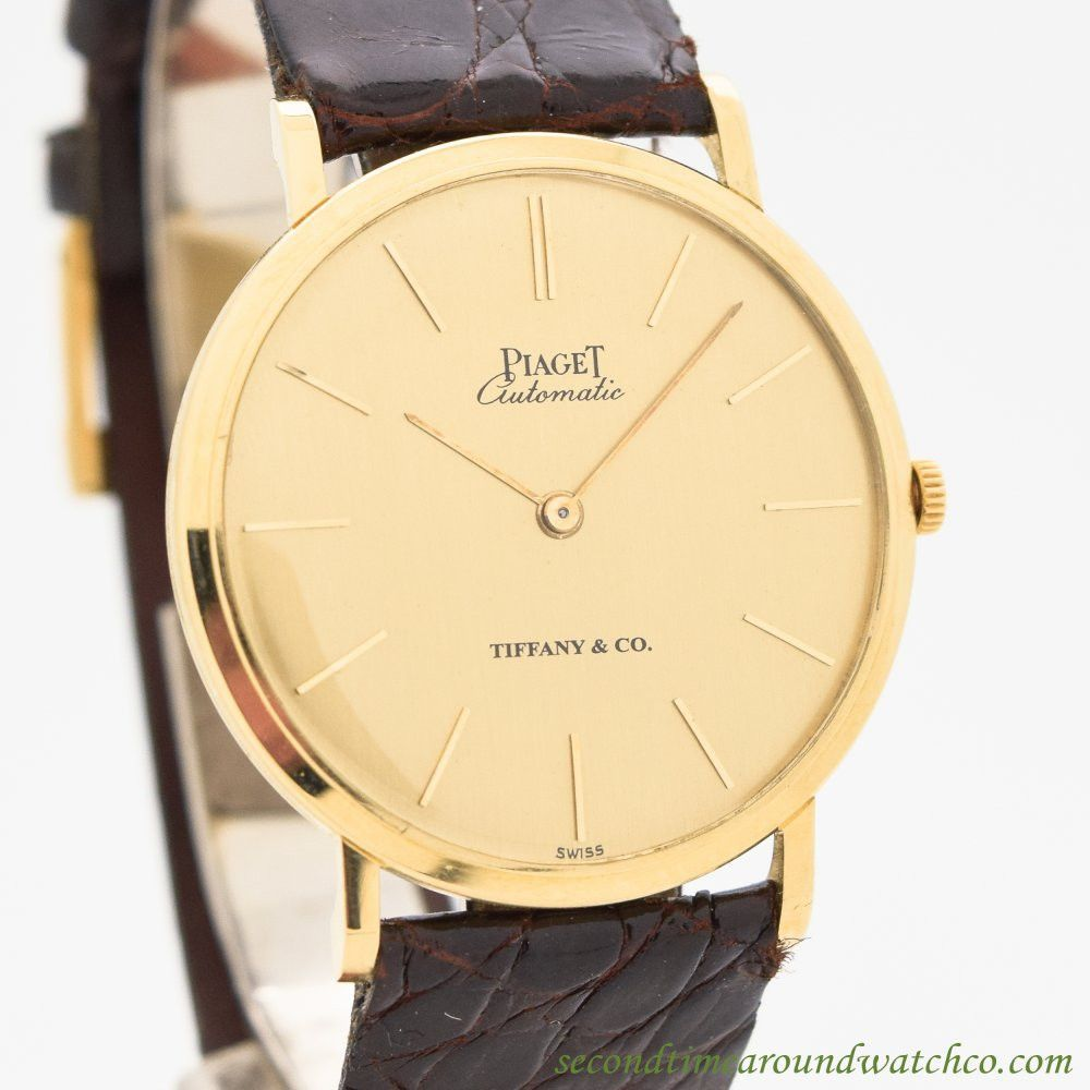 1980's Vintage Piaget Ultra-Thinomatic Automatic 18k Yellow Gold watch Originally Retailed by Tiffany & Co. with Original Champagne Dial with Gold Bar Markers with Original 18k Yellow Gold Piaget Buck