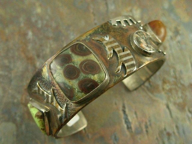 Cuff | Victoria Maase Stoll.  Copper, sterling silver, tiger iron, amber, leopard jasper, oolite, gaspeite and jasper