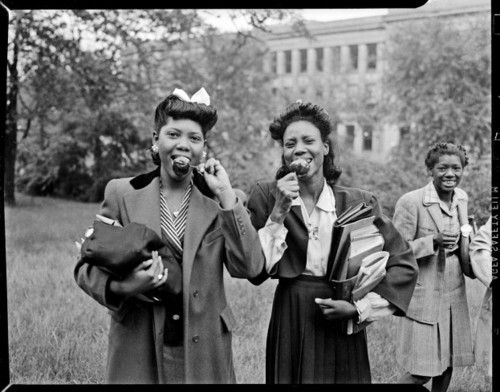 Two young women eating caramel apples (possibly Schenley High School), 1940s. Teenie Harris. [Carnegie Museum of Art]     Teenie Harris, Photographer: An American Story: Carnegie Museum of Art, on exhibit until April 7, 2012