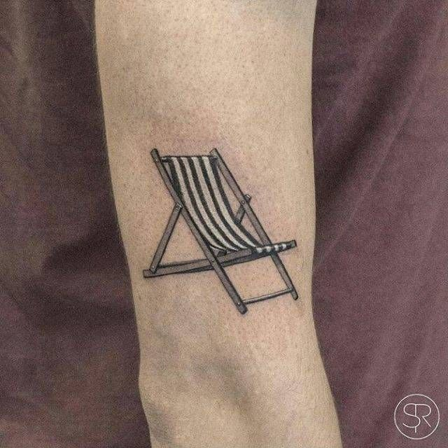 Fine Line Style Beach Chair Tattoo On The Upper Arm Tattoos Elbow Tattoos Back Of Arm Tattoo