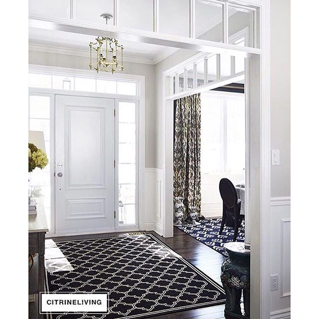 Entryway Paint Colors open concept entryway and dining room using layers of pattern