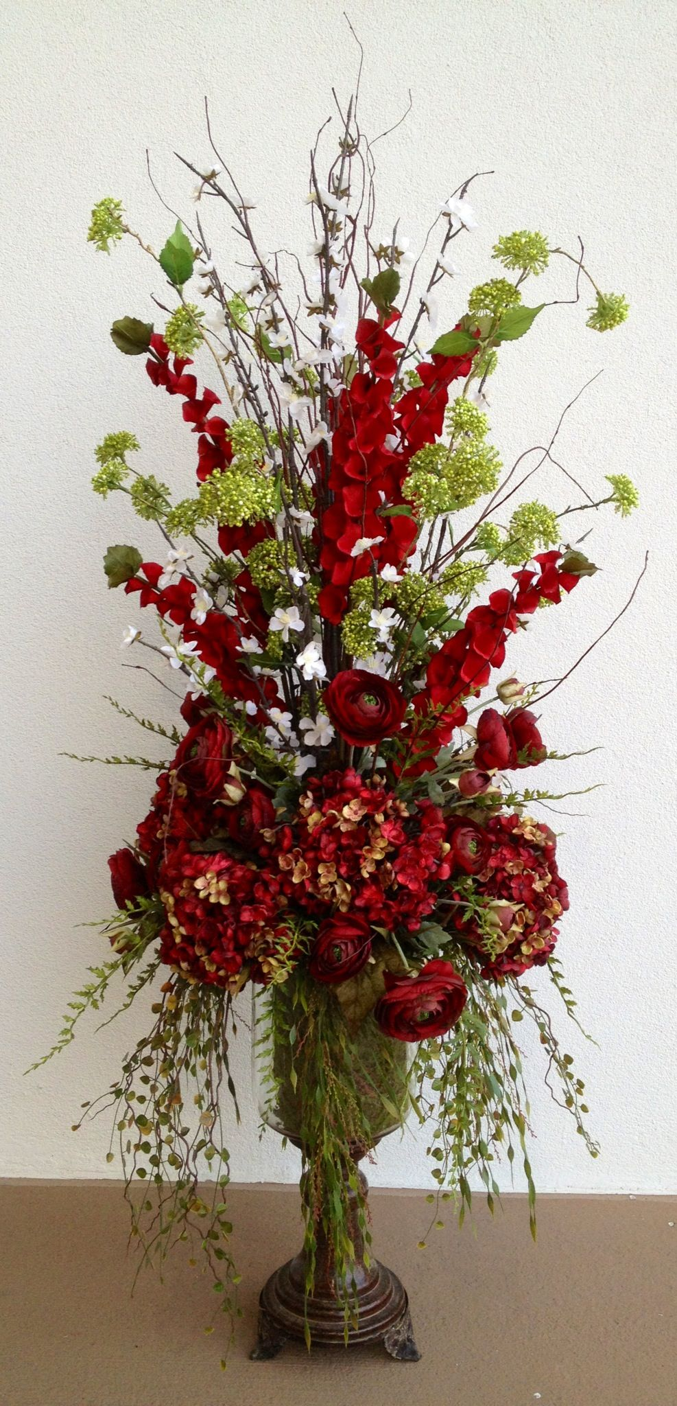 Red hydrangea with ranunculus arrangement designed by