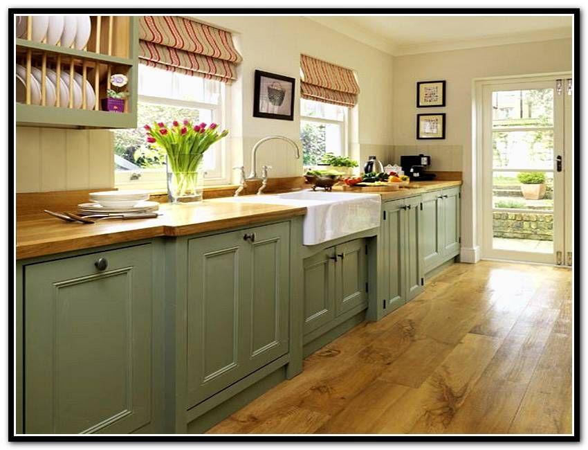 Kitchen - Sage green cabinets; butter yellow beadboard