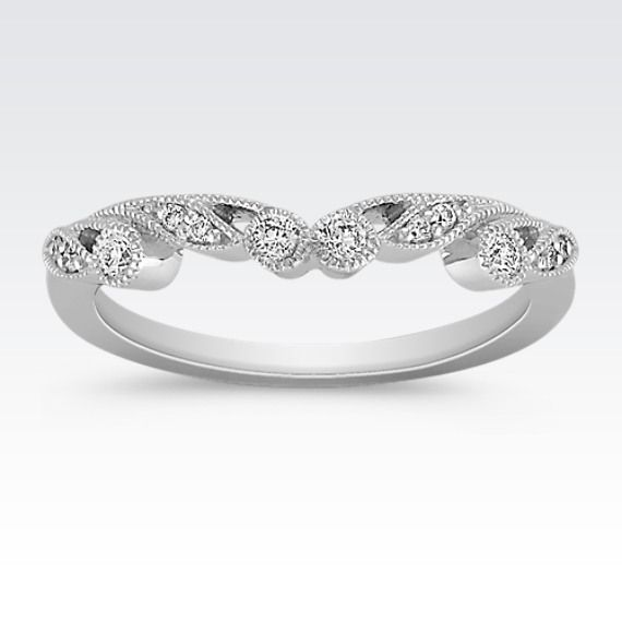 This stylish vintage inspired wedding band is crafted in quality