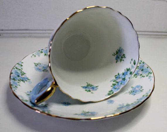 Something borrowed, something blue......    A lovely, delicate vintage demitasse tea cup and saucer is a reminder of Spring. This beautiful cup