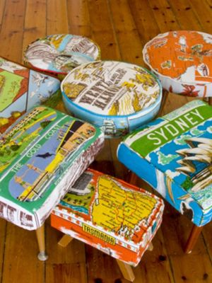 Non-cheesy ways to decorate your home with travel keepsakes...#1...use memento tea towels to upholster footstools....