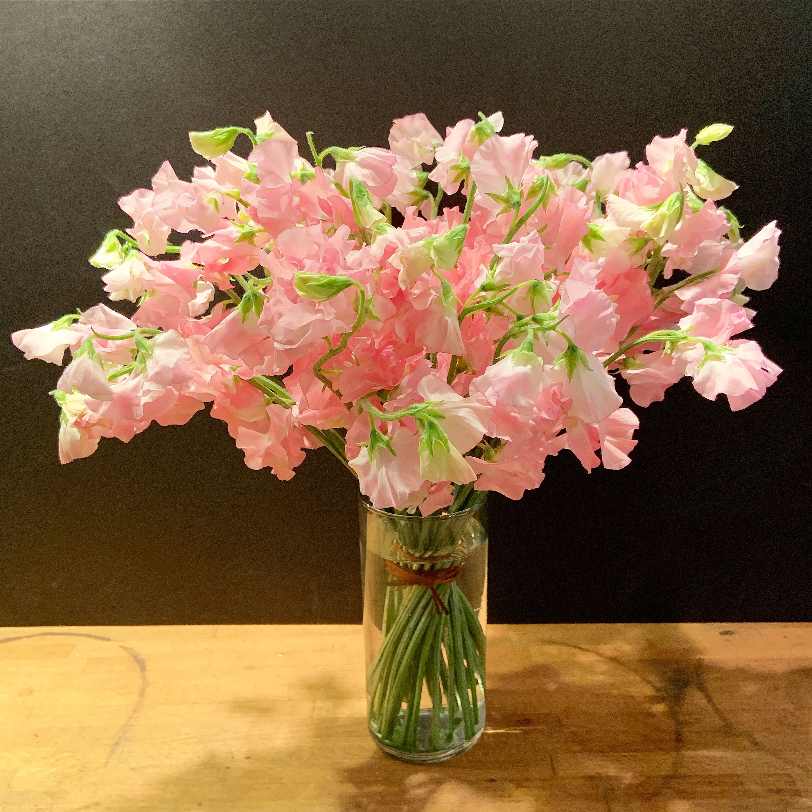 Sweet peas in a clear vase Flower delivery, Same day