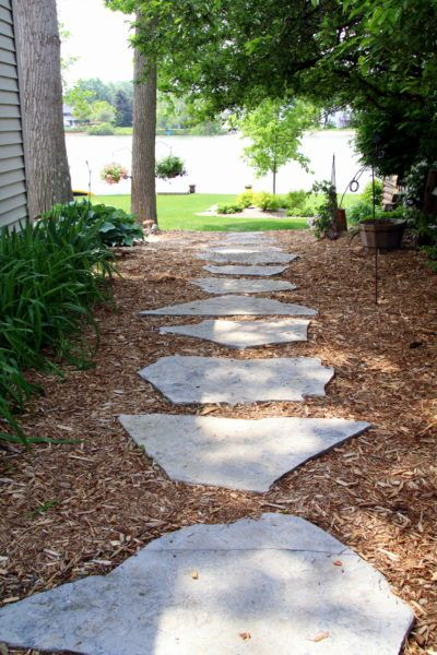 Enchanting Small Garden Landscape Ideas With Stepping Walk: Stone Walkway Surrounded By Bark Mulch