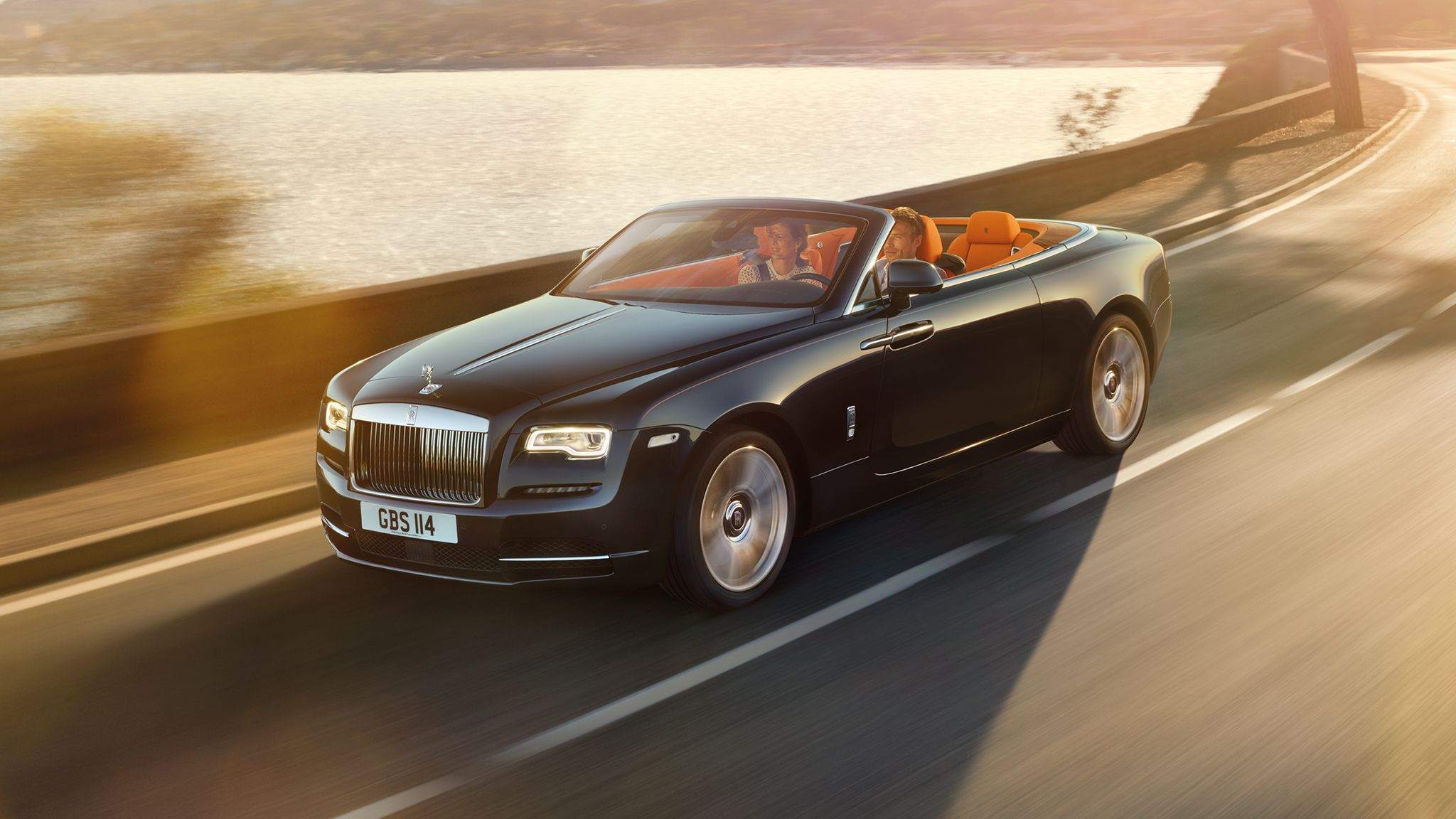 New rolls royce dawn convertible interior in orange and luxury accesories