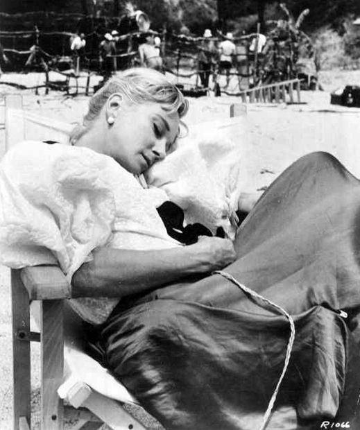 Joan Greenwood takes a nap between scenes of Mysterious Island