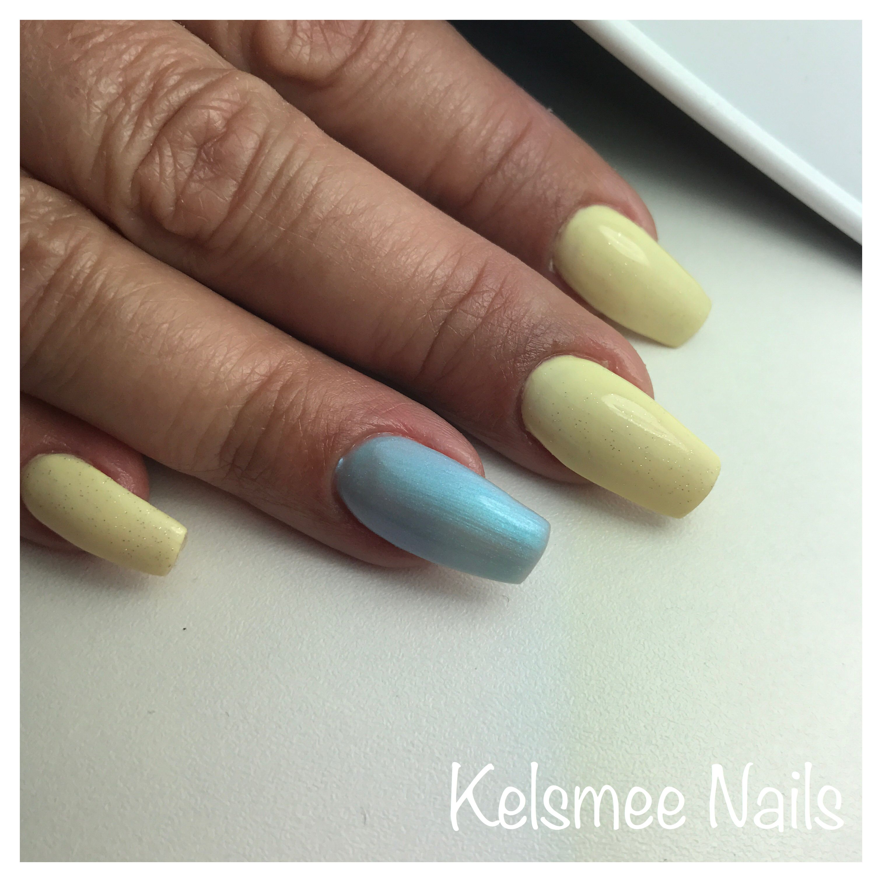 Yellow nails with Blue