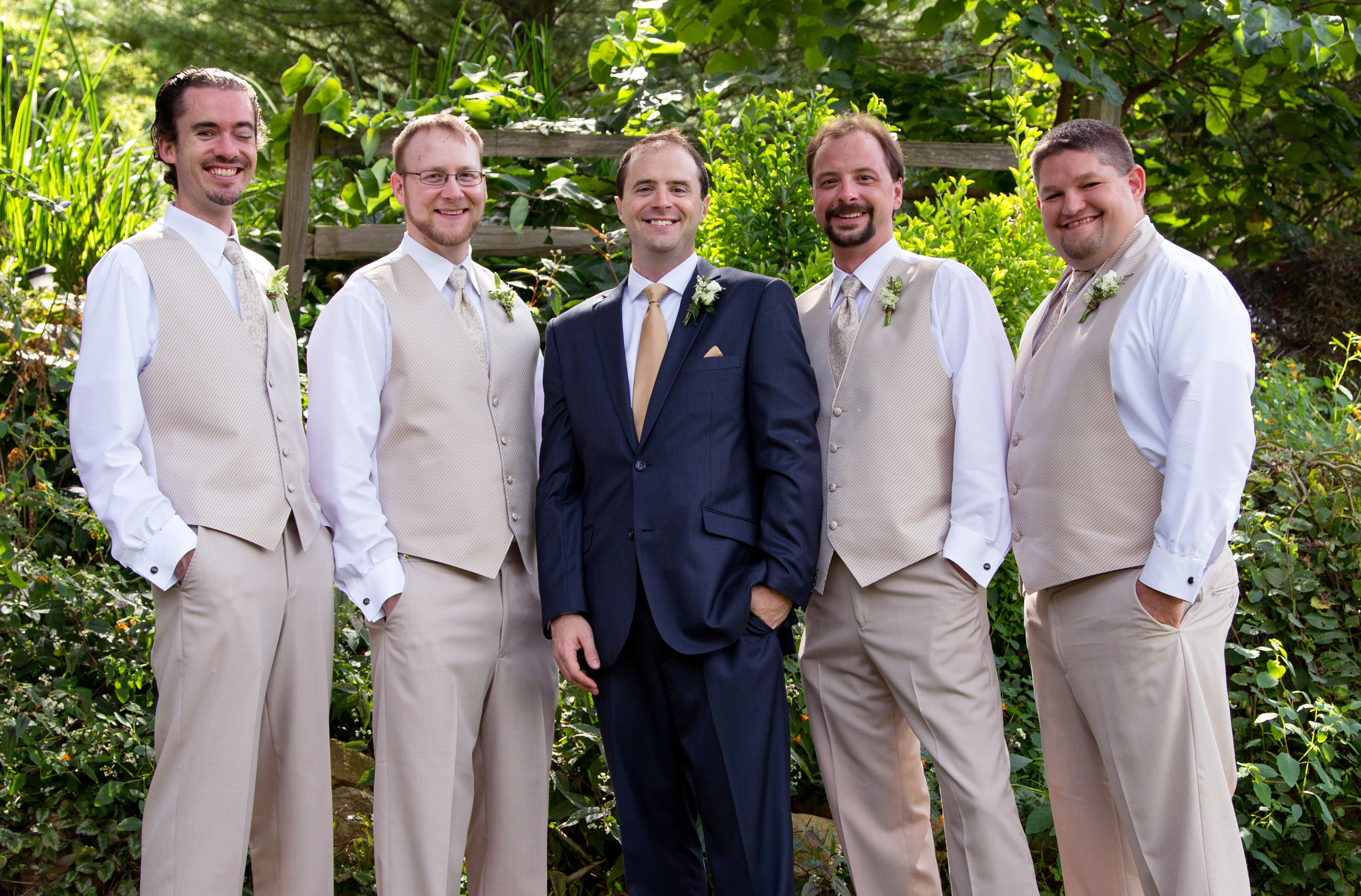 Groomsmen Groom In Navy Suit With Champagne Tie Groomsmen In Tan Vests Wedding Blue Suit Wedding Champagne Bridesmaid Dresses Groomsmen Attire