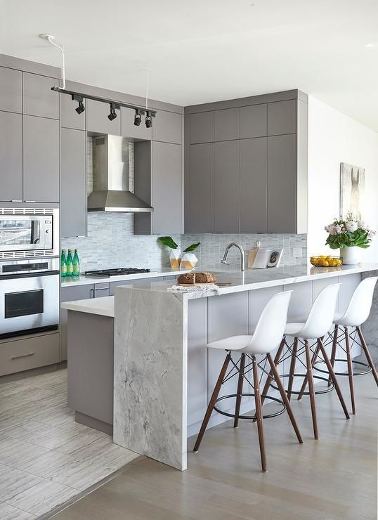 Best Modern Kitchen With A Super White Granite Waterfall 640 x 480