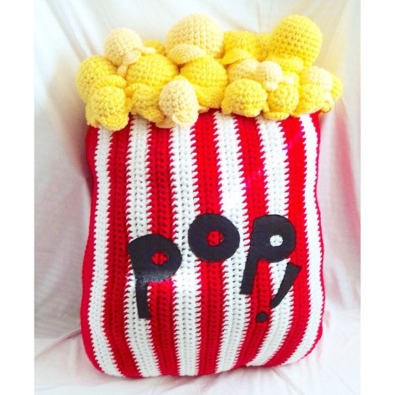 This 36 inch tall, hand crocheted popcorn pillow is perfect for cuddling up with on movie nights.