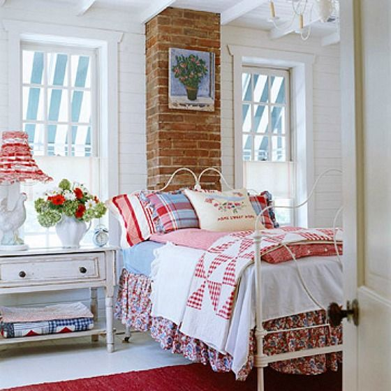 A Country Farmhouse Decorated With Red White And Blue Cottage