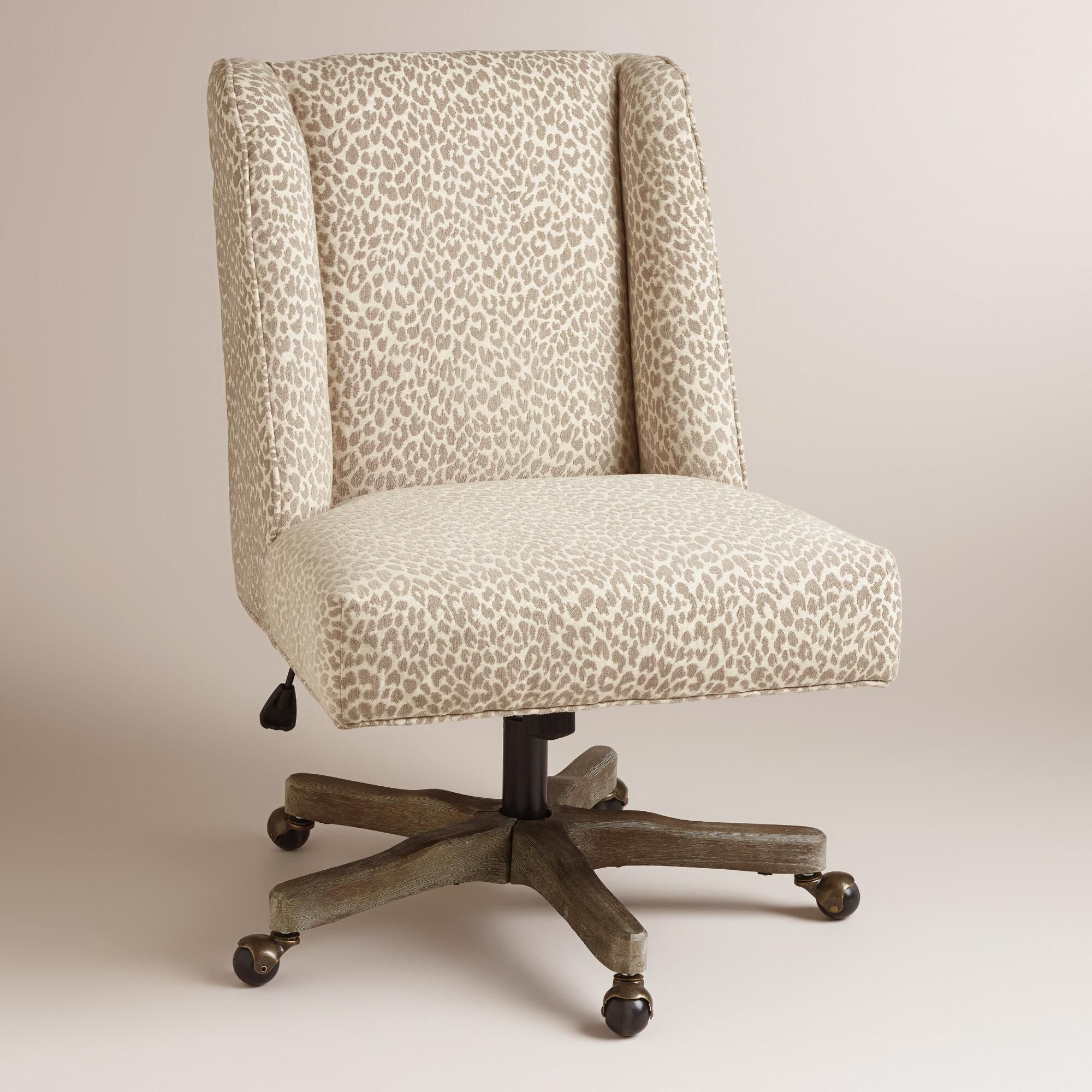 revolving chair features kitchen table chairs with rollers an updated wingback profile and natural hued leopard