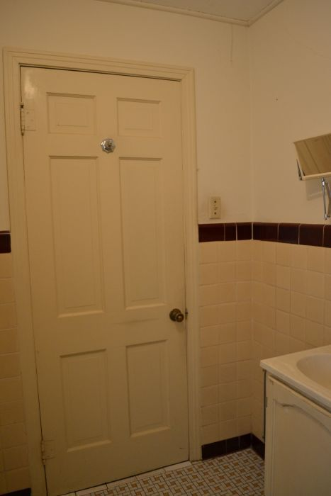 bathroom before remodel original late 1940s early 1950s tiled walls and mosaic tile floor