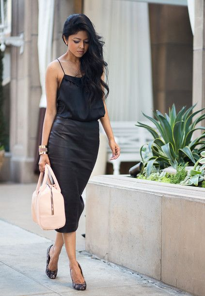 $35 - $458 Capture the attention of the street-style set with this black top and skirt, pastel handbag and black pumps.