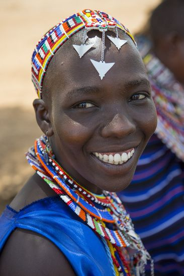 Portrait of a Masai woman with glass bead jewelry in a Masai village outside Amboseli National Park in Kenya.