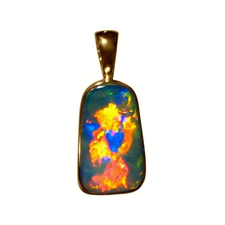 A very special Opal pendant in 14k Yellow Gold with amazing brightness and colors inlaid in a custom made pendant setting. One only