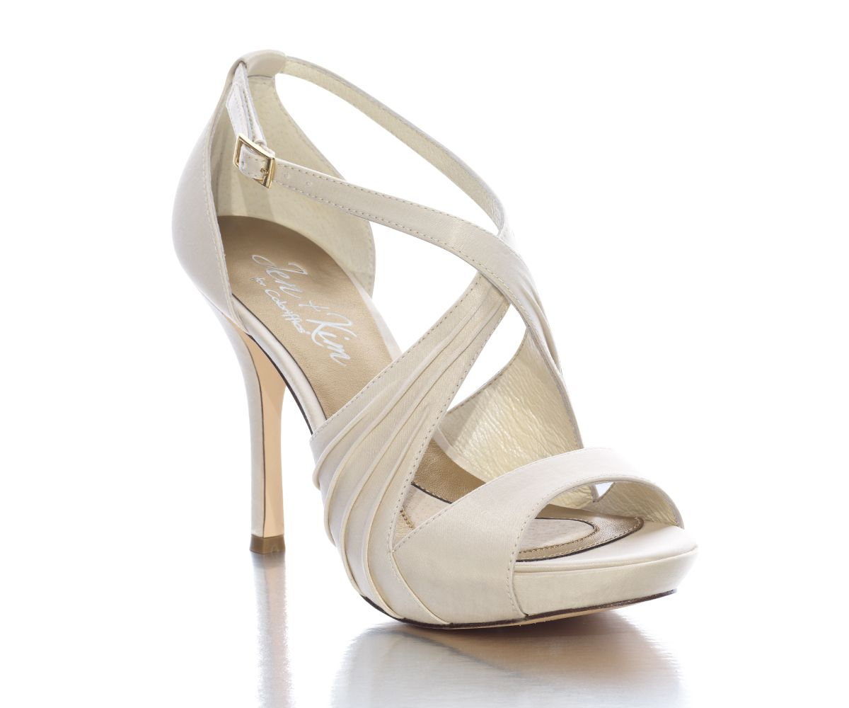 The feminine straps, accentuated with flat pleating, crisscross the instep to create an eye-catching platform sandal and provide the comfort that security brings.