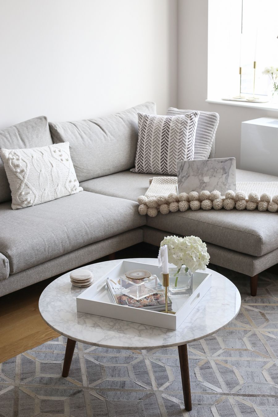 NYC Living Room Apartment - grey sectional sofa with a marble coffee ...