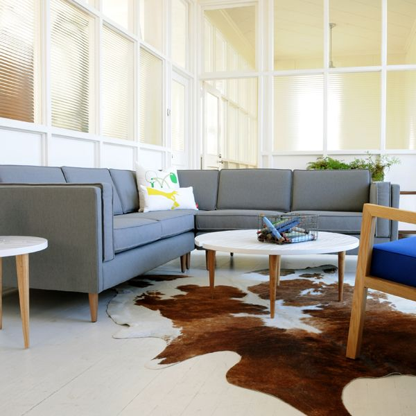 We #love the Adelaide Bi-Sectional with the cowhide accent rug