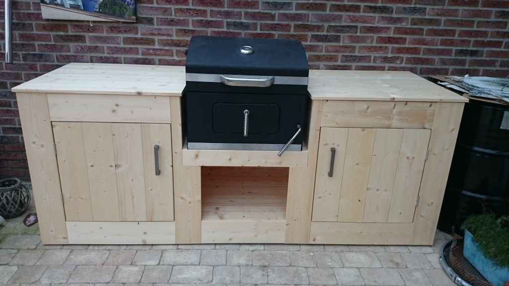 Very neat outdoor kitchen. No screws visible. It's located under a roof, however it needs a bit of paint to make it weather proof. source: www.techandmore4you.com