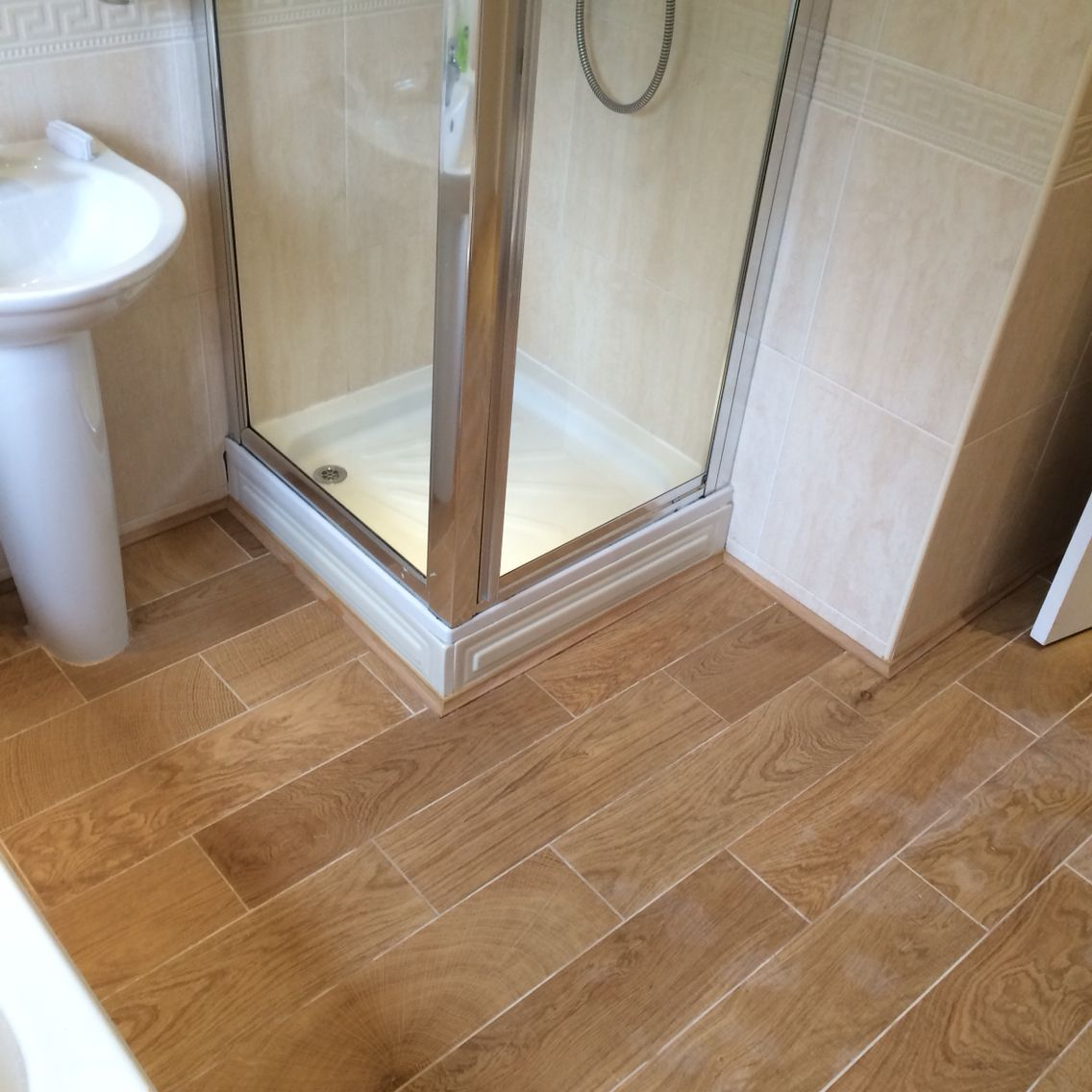 Wood look tiles finished with oak edging strip around