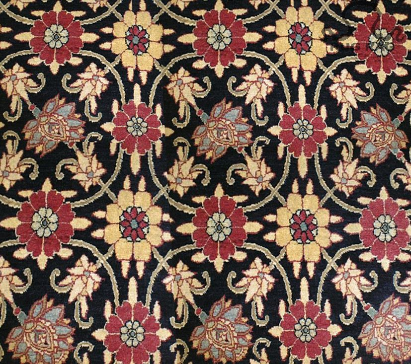"""Mina Khani Design in Oriental Rugs—a repeating field pattern. The isolated design generally features a main palmette surrounded by a circular vine, and eight alternating-colored stylized flowers. While the isolated repeating pattern is square, the overall impression appeals to what would be classified as a """"lattice"""" design. Flowers used often resemble a top view of a pomegranate."""