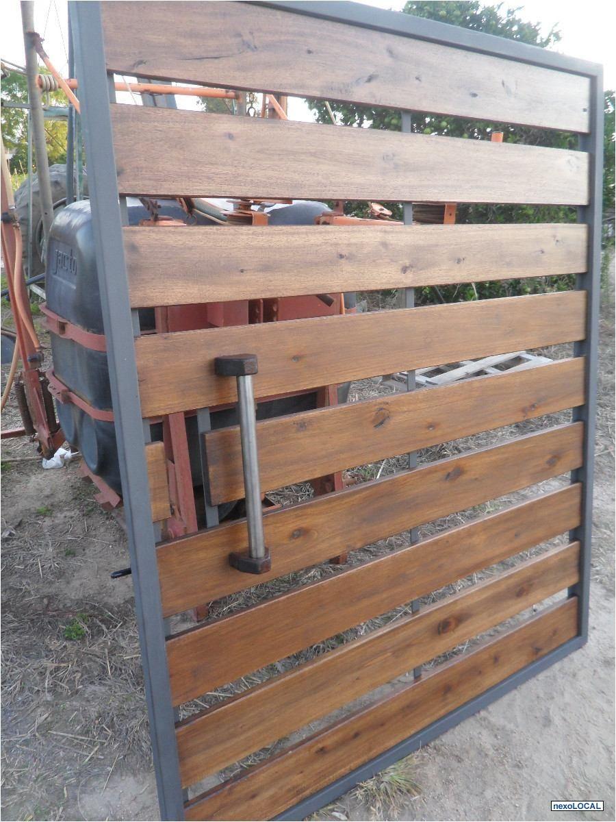 Porton en hierro y madera canelones hogar muebles for Puertas y portones de madera