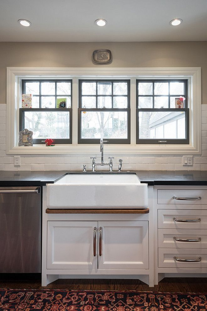 Kitchen with painted window frames above sink. Kitchen painted ...