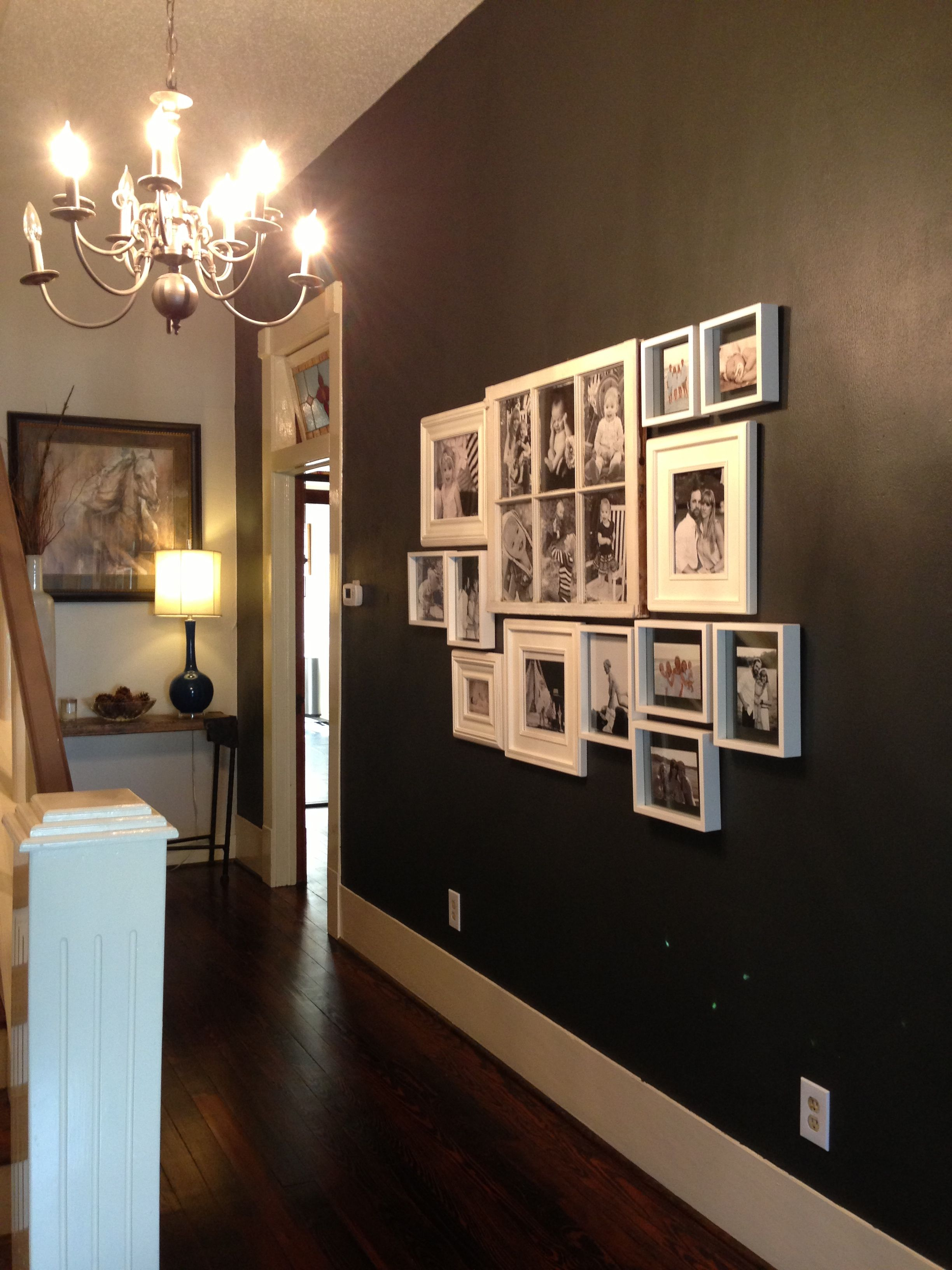 Sherwin Williams Iron Ore Accent Wall With A Collage Of