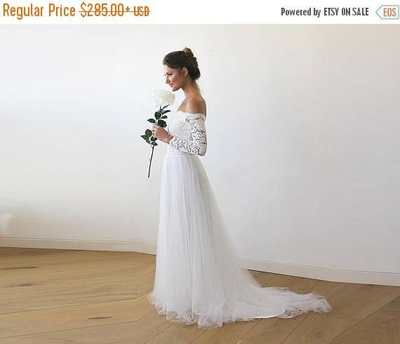 Atemberaubende Brautkleid mit romantischen Tüll Zug. Das ...