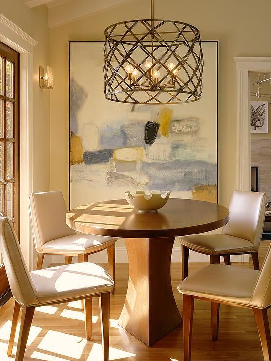 The breakfast area showcases a Coddington-designed chandelier and