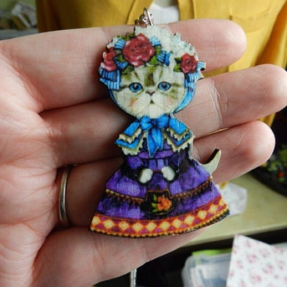 Crazy cat lady necklace This fancy dressed cat necklace is made from laser cut wood. She's got a cute little flower crown, a vintage fancy dress and a basket of flowers. What crazy cat lady doesn't need this!? Necklace chain is nickel & lead free. Handmade/ brand new. Bundle & save 15% on 3+ items  Abbie's Anchor Jewelry Necklaces