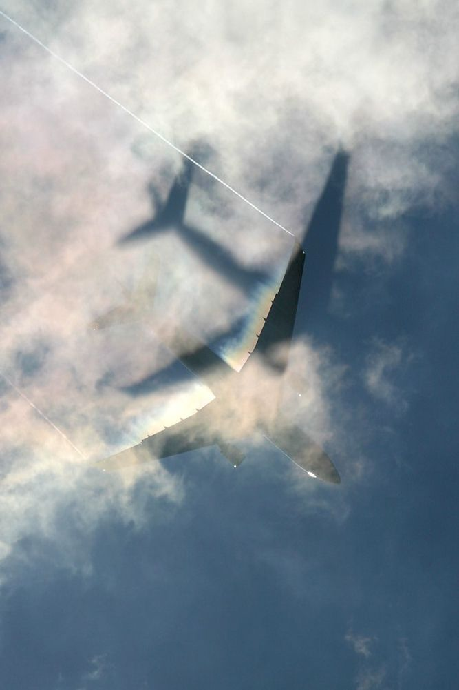 Airplane shadow on the clouds.